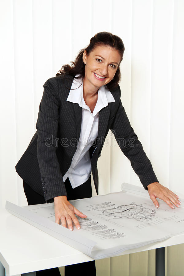 Download Architect With Blueprint In The Office. Stock Image - Image: 18511723
