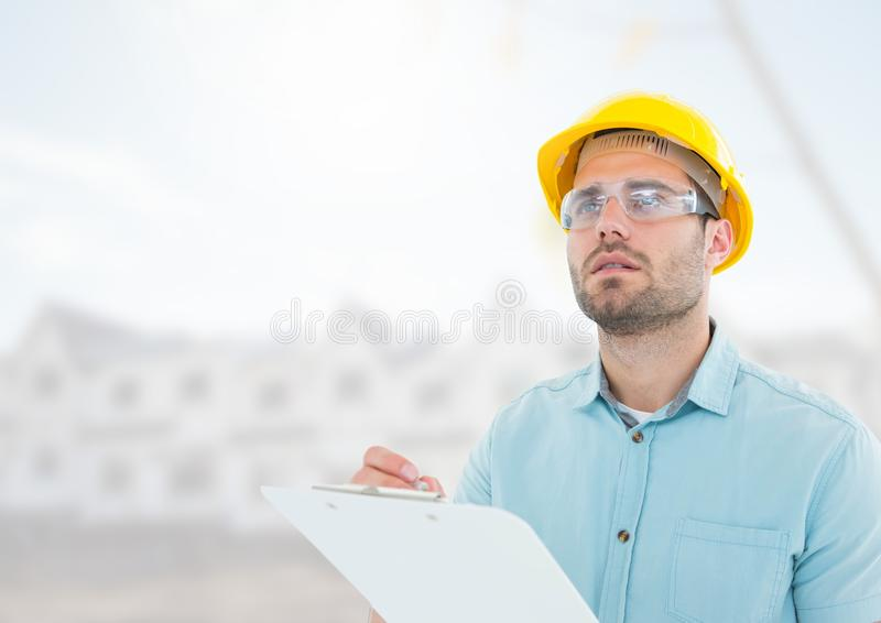 Architect with blueprints on building site stock photos