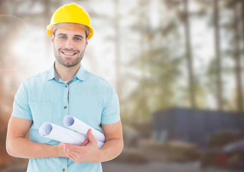 Architect with blueprints on building site stock photography