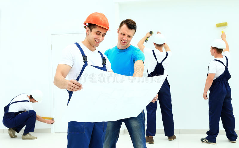 Architect and client discussing the plan stock image
