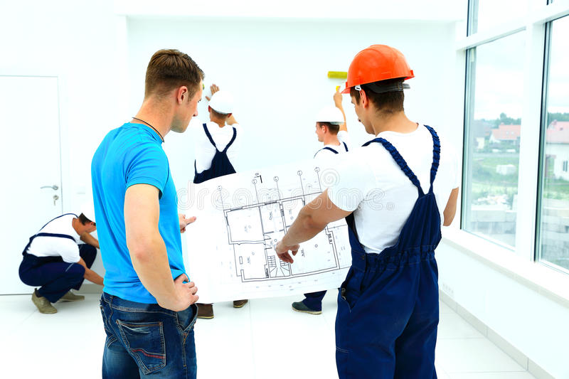 Architect and client discussing stock image