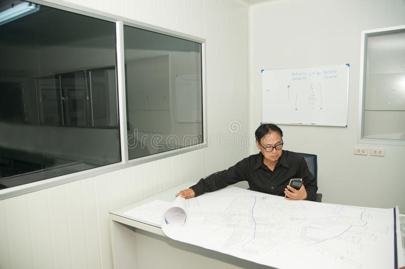 Architect and construction engineer discussing plan in office. royalty free stock photos