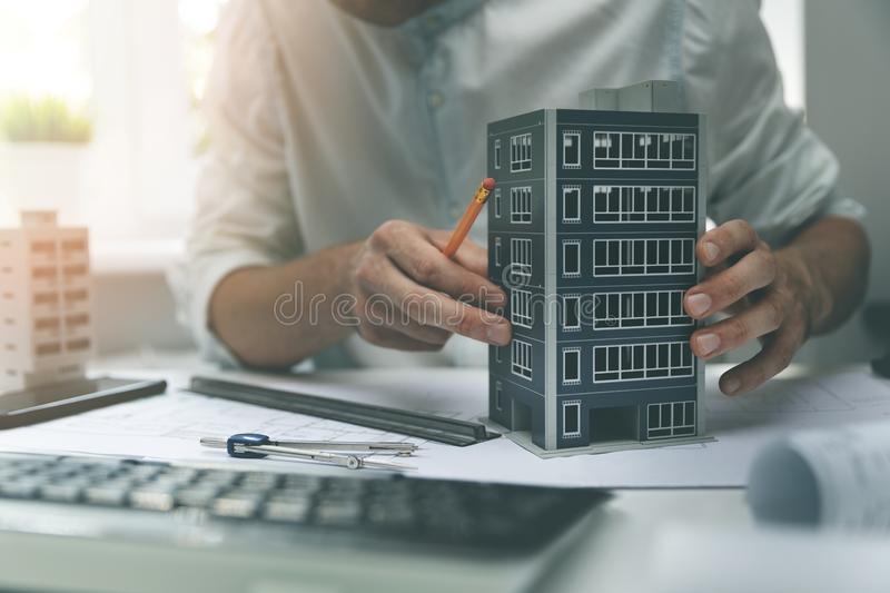 Architect construction engineer working on new apartment building project stock photos