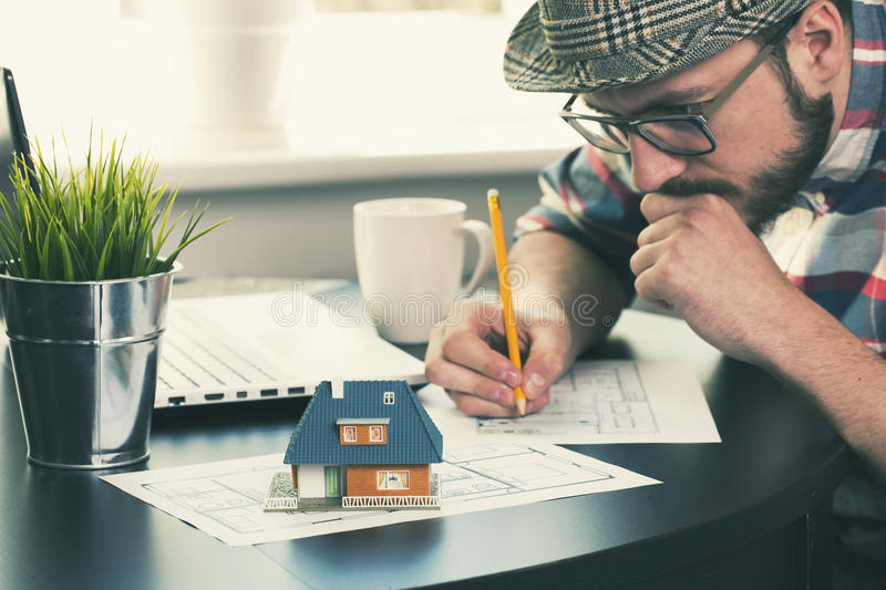 Architect, construction engineer working on new house project stock photo