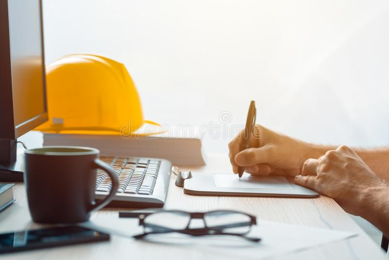 Architect construction engineer working with sketch pen tablet i. N office making a construction project in CAD software, selective focus royalty free stock photography
