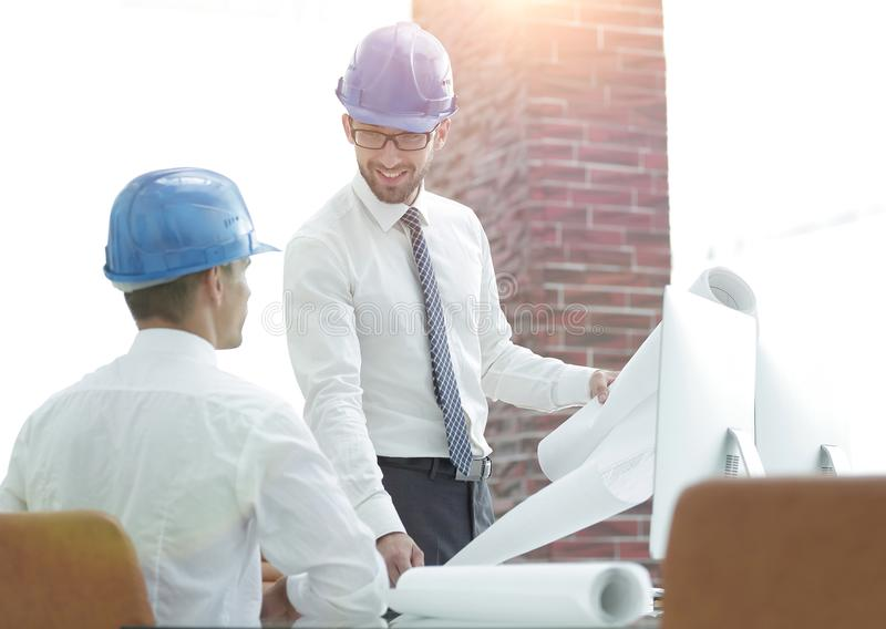 Architect and construction foreman to discuss a new project royalty free stock photography