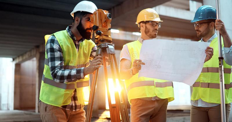 Architect consult engineer on construction site stock images