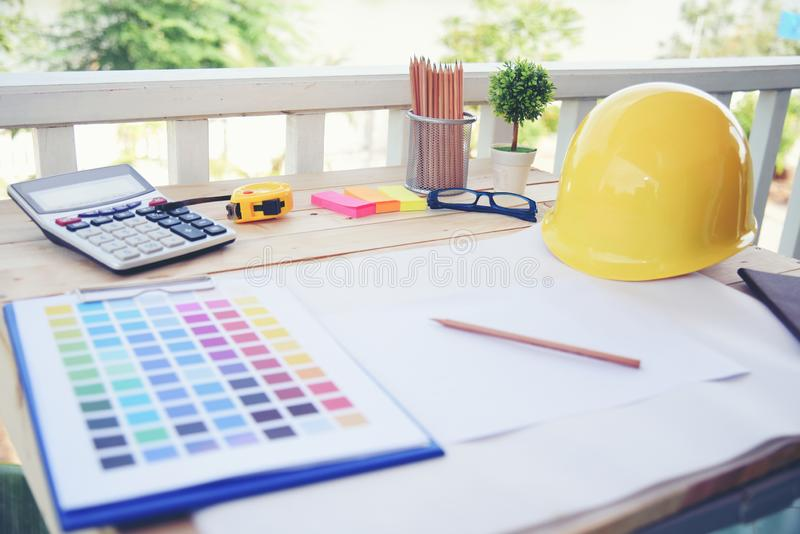 Architect Designer work project. creative design desk  on wood table. Co-worker discuss on plan paper. Horizontal Photo. Architect Designer work project stock photography