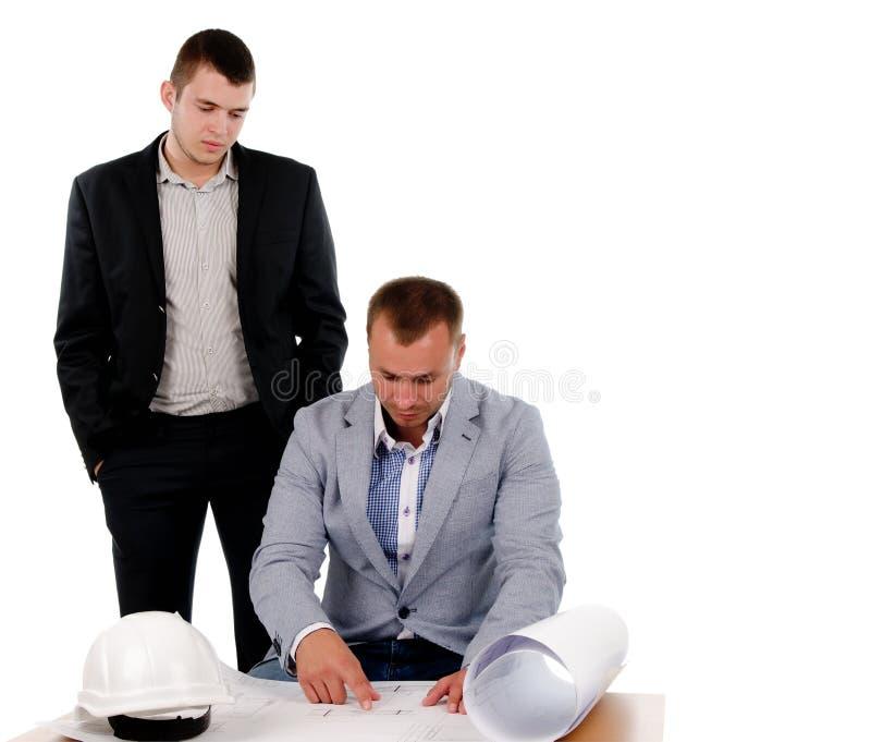 Architect die bij de bouw van plannen werken stock afbeelding