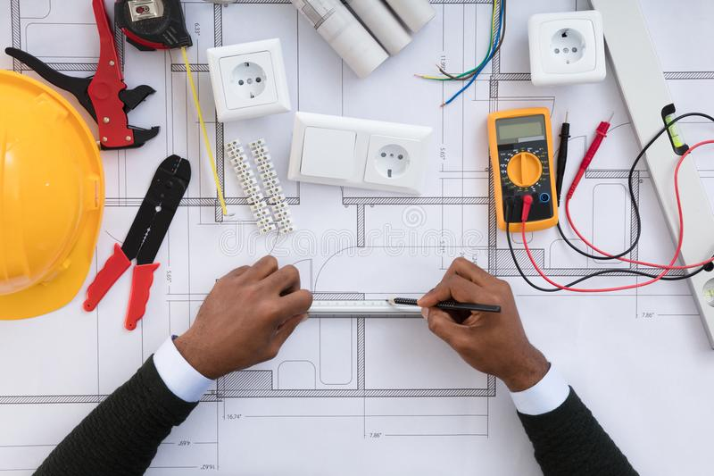 Architect Drawing Plan On Blueprint stock image