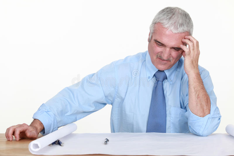 Architect dubious of his plans. stock image