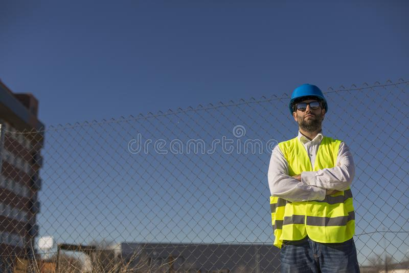Architect or Engineer on the Construction Site. Daytime. Wearing protection equipment stock image