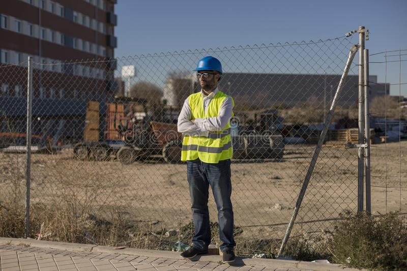 Architect or Engineer on the Construction Site. Daytime. Wearing protection equipment stock images