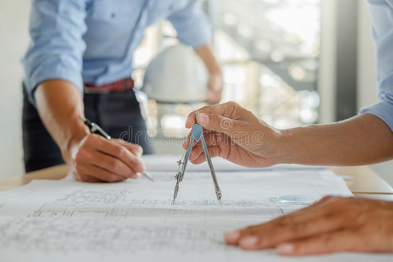 Architect Engineer Design Working on Blueprint Planning Concept. royalty free stock image