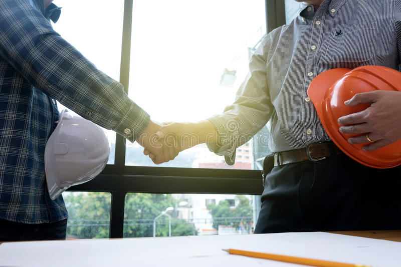 Architect or engineer hand shake royalty free stock photo