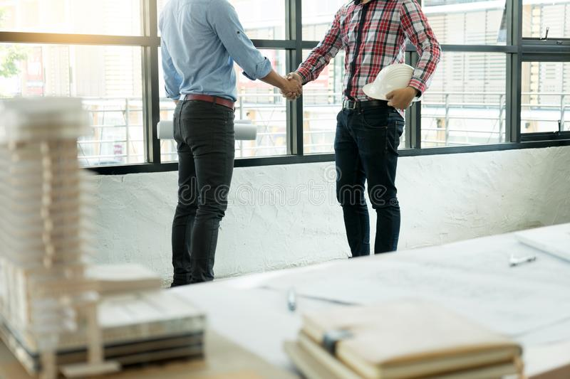 Architect or engineer handshake for teamwork. And business project run good royalty free stock images