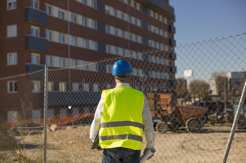 Architect or Engineer holding blueprints on the Construction Sit stock image