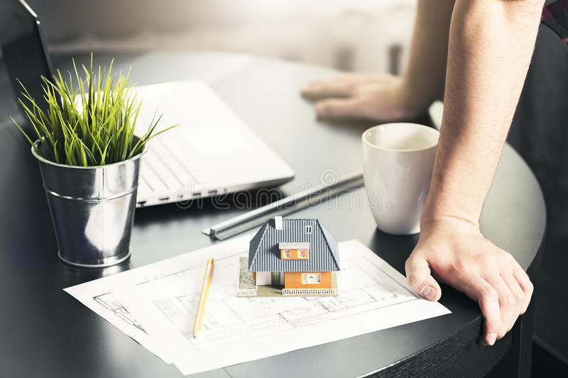 architect, engineer occupation - man working on new house project stock photography