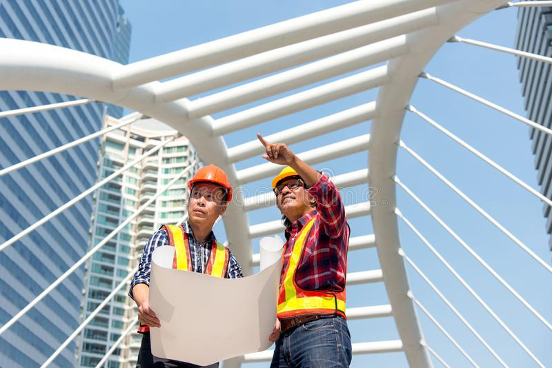 Architect engineer team planning blue print in construction city site. royalty free stock images