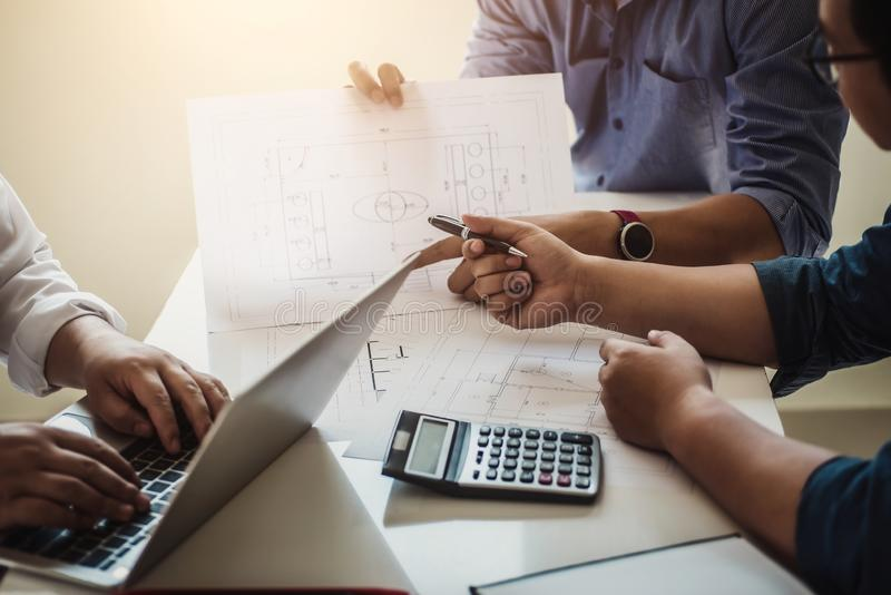 Architect or engineer team working with blueprints building plan design project in office Construction engineering tools and stock photography