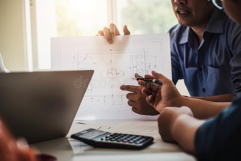 Architect or engineer team working with blueprints building plan design project in office Construction engineering tools and royalty free stock images