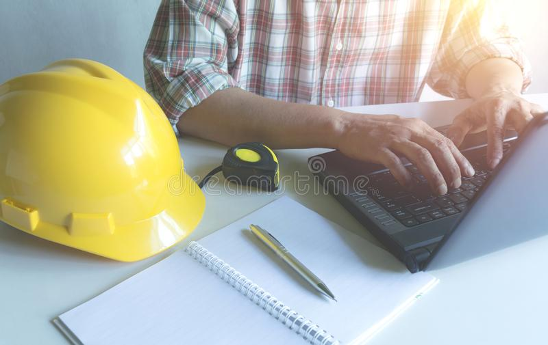 Architect engineer working concept with laptop and construction royalty free stock image