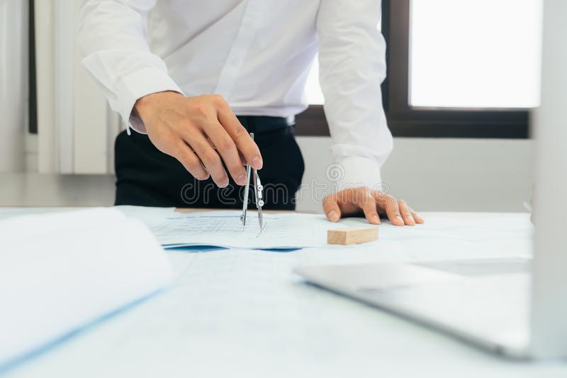 Architect or engineer working in office royalty free stock image