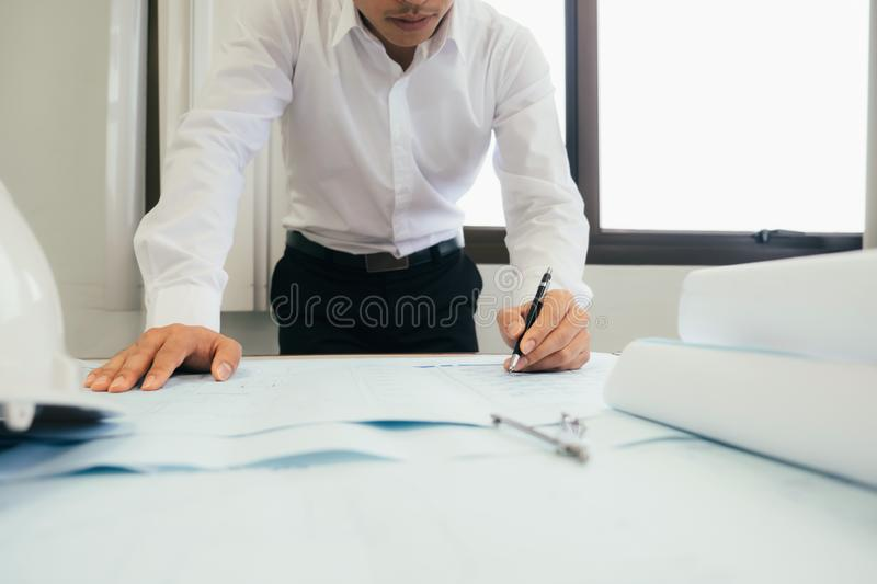 Architect or engineer working in office stock image