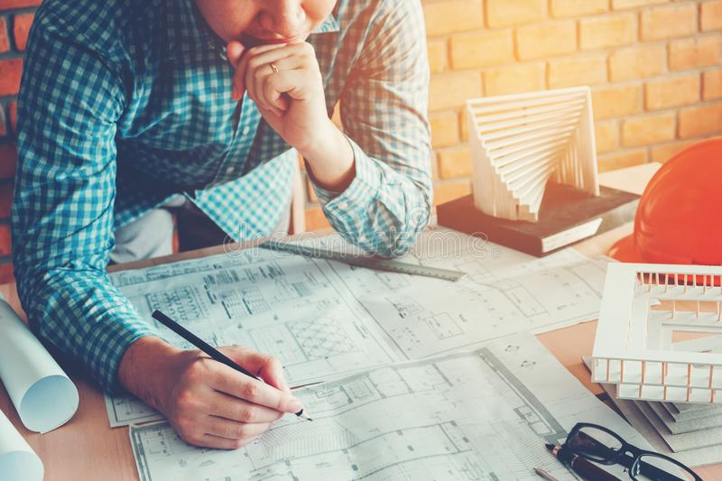 Architect or engineer working in office on blueprint. Architects stock photo