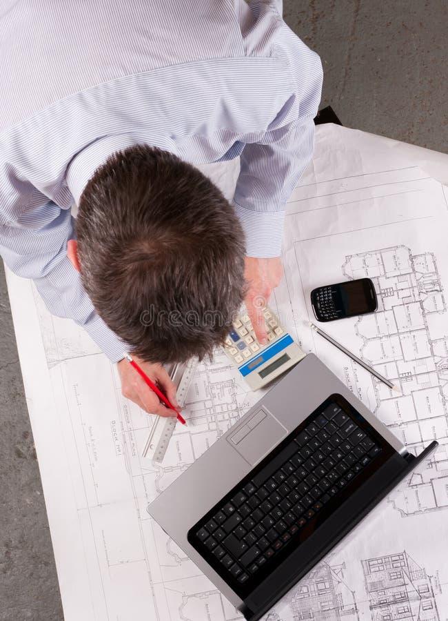 Free Architect Examines Plans Royalty Free Stock Photography - 16163807