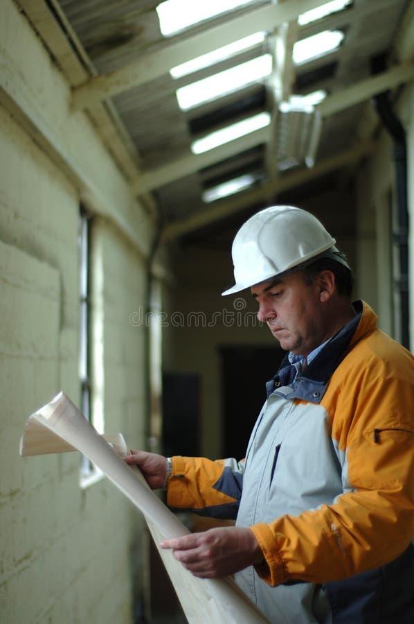 Download Architect Examining Blueprint Stock Image - Image: 1221501