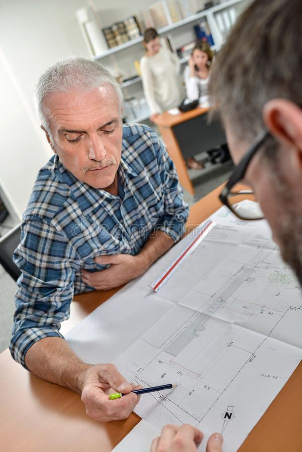 Architect explaining something to client royalty free stock images