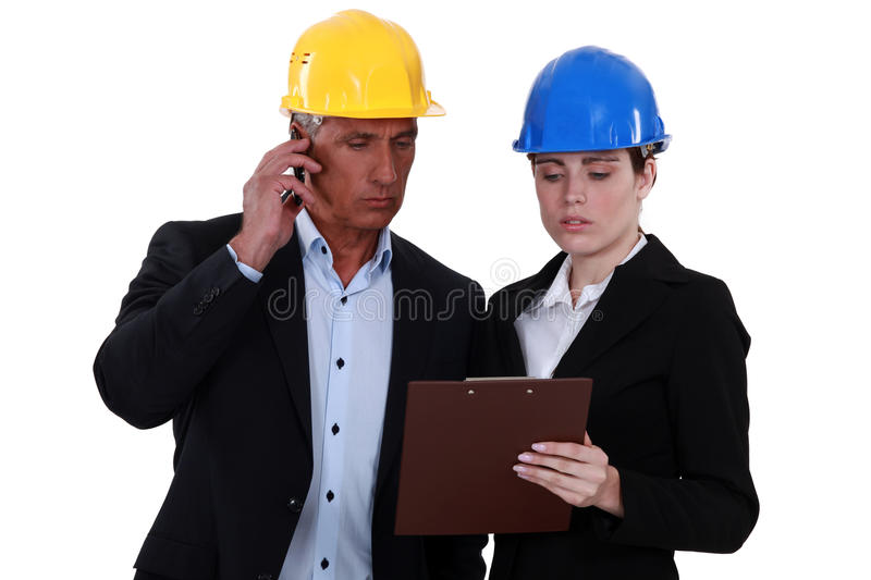 Architect and female assistant. Discussing plans royalty free stock photos