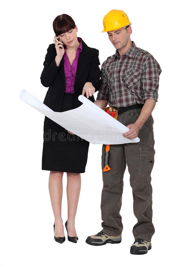 Download Architect and foreman stock photo. Image of female, blueprints - 26586696