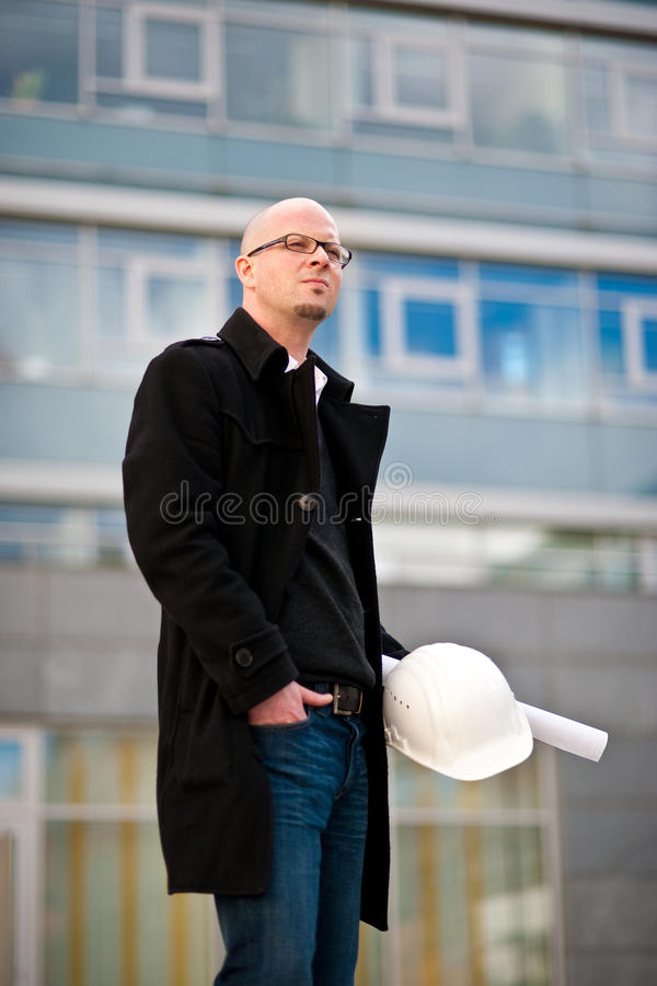 Architect with helmet and plan royalty free stock images