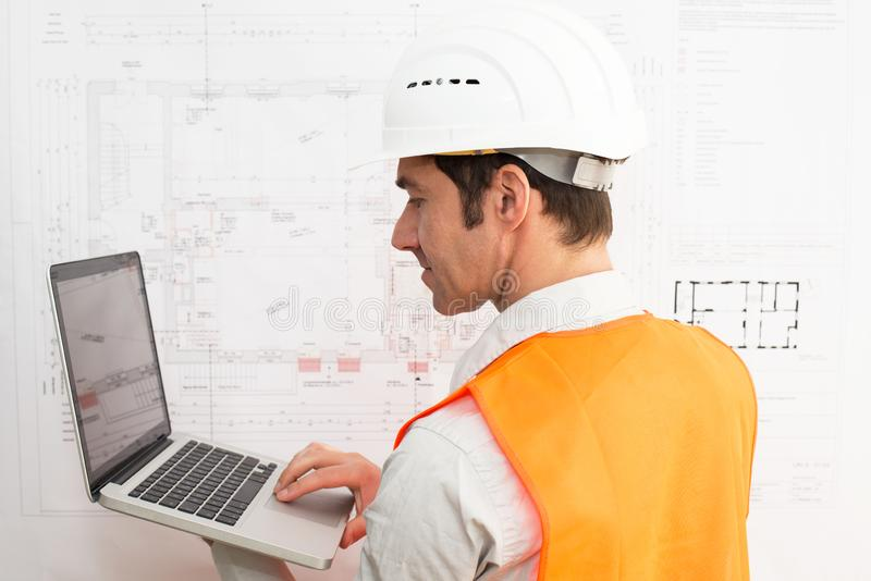Architect at his workplace with notebook - house building and co royalty free stock photography