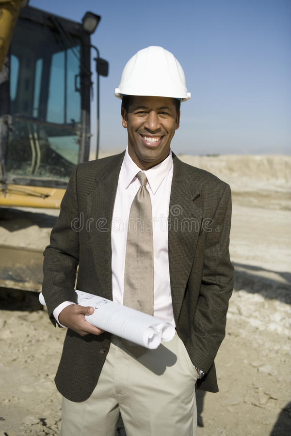 Download Architect Holding Blueprint At Construction Site Royalty Free Stock Image - Image: 29652636