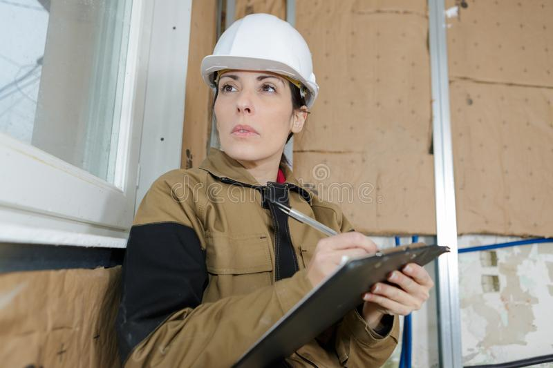 Architect holding blueprints and clipboard royalty free stock image