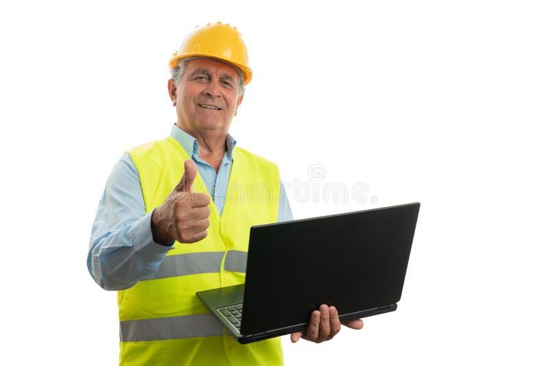 Architect holding laptop making like gesture stock images