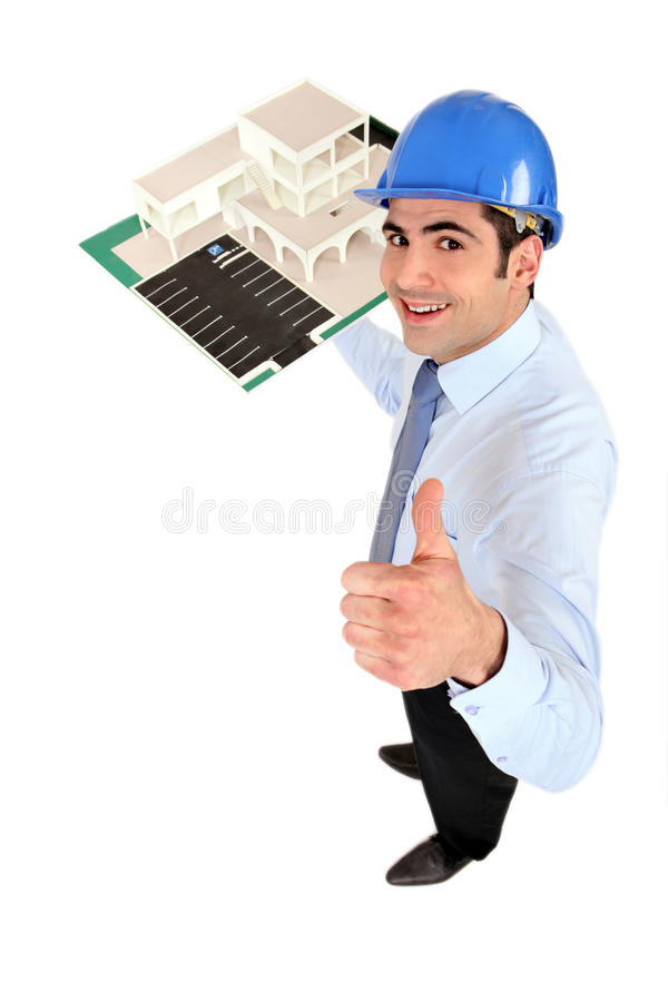 Architect Holding Model Housing Royalty Free Stock Image