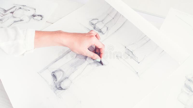 Architect job creative occupation skills sketching. Architect job. Creative occupation skills. Lefthanded female graphic designer working on project royalty free stock image