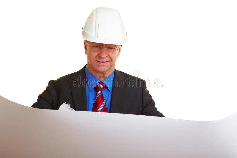 Architect looking at plans royalty free stock image