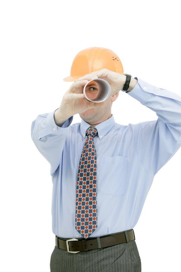 Architect looking through tube stock photo
