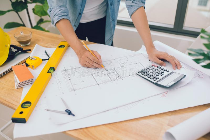architect man working with laptop and blueprints,engineer inspection in workplace for architectural plan,sketching a construction royalty free stock photos