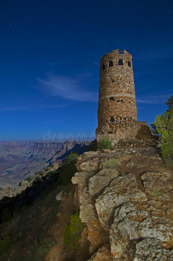 A long exposure of the Watchtower in the Grand Canyon at night. stock photography