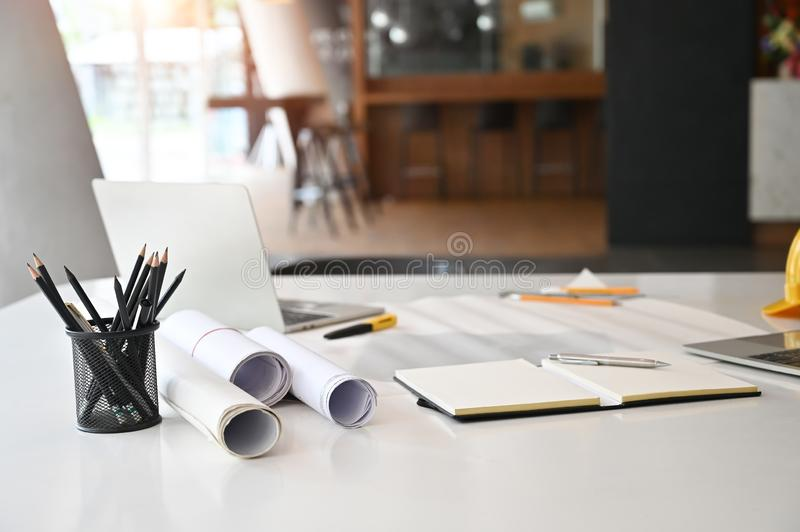 Architect  Office desk with blueprint, laptop computer, pencil on engineering workspace royalty free stock photography