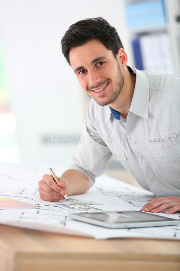 Architect at office working. Architect in office drawing construction blueprint royalty free stock photo