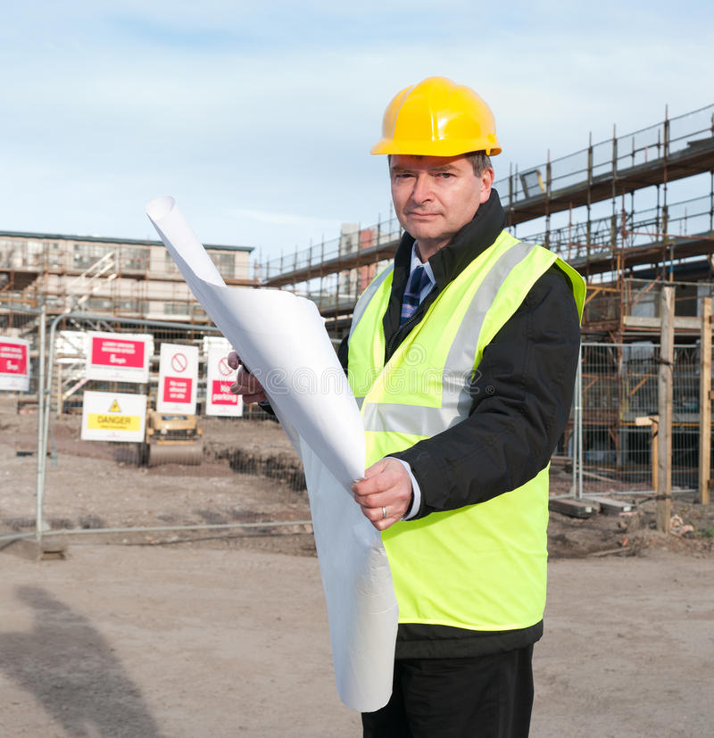 Free Architect On Building Site Looks At Camera Royalty Free Stock Image - 16129536
