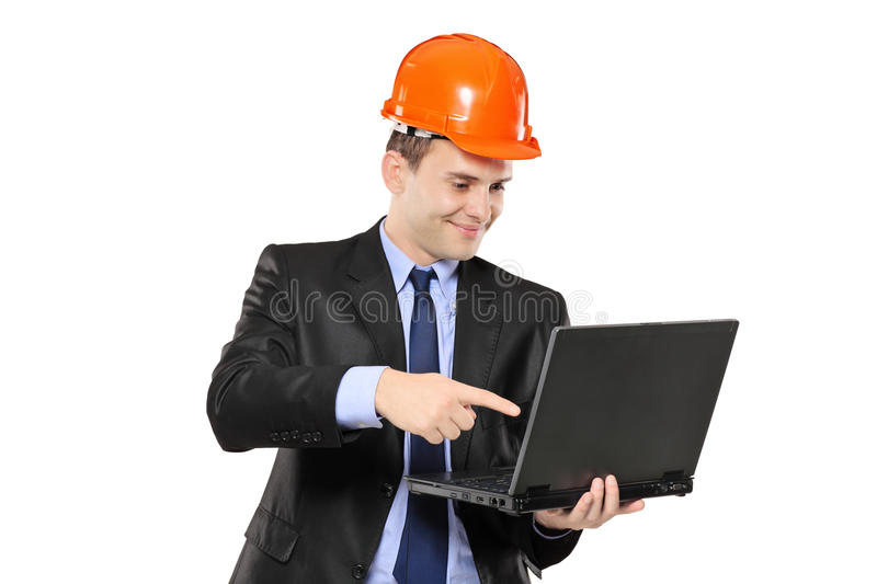 An architect pointing at laptop royalty free stock photography