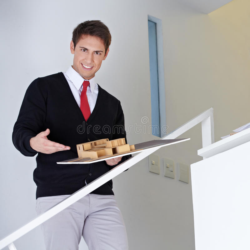 Download Architect Presenting House Model Stock Photo - Image: 27003670